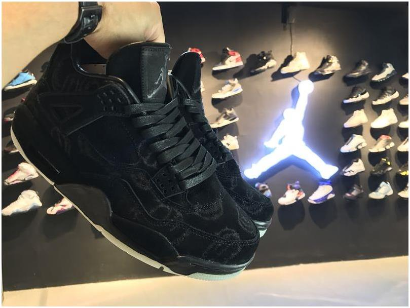 KAWS x Air Jordan 4 Premium Black Suede Glow in the Dark Sole For Sale